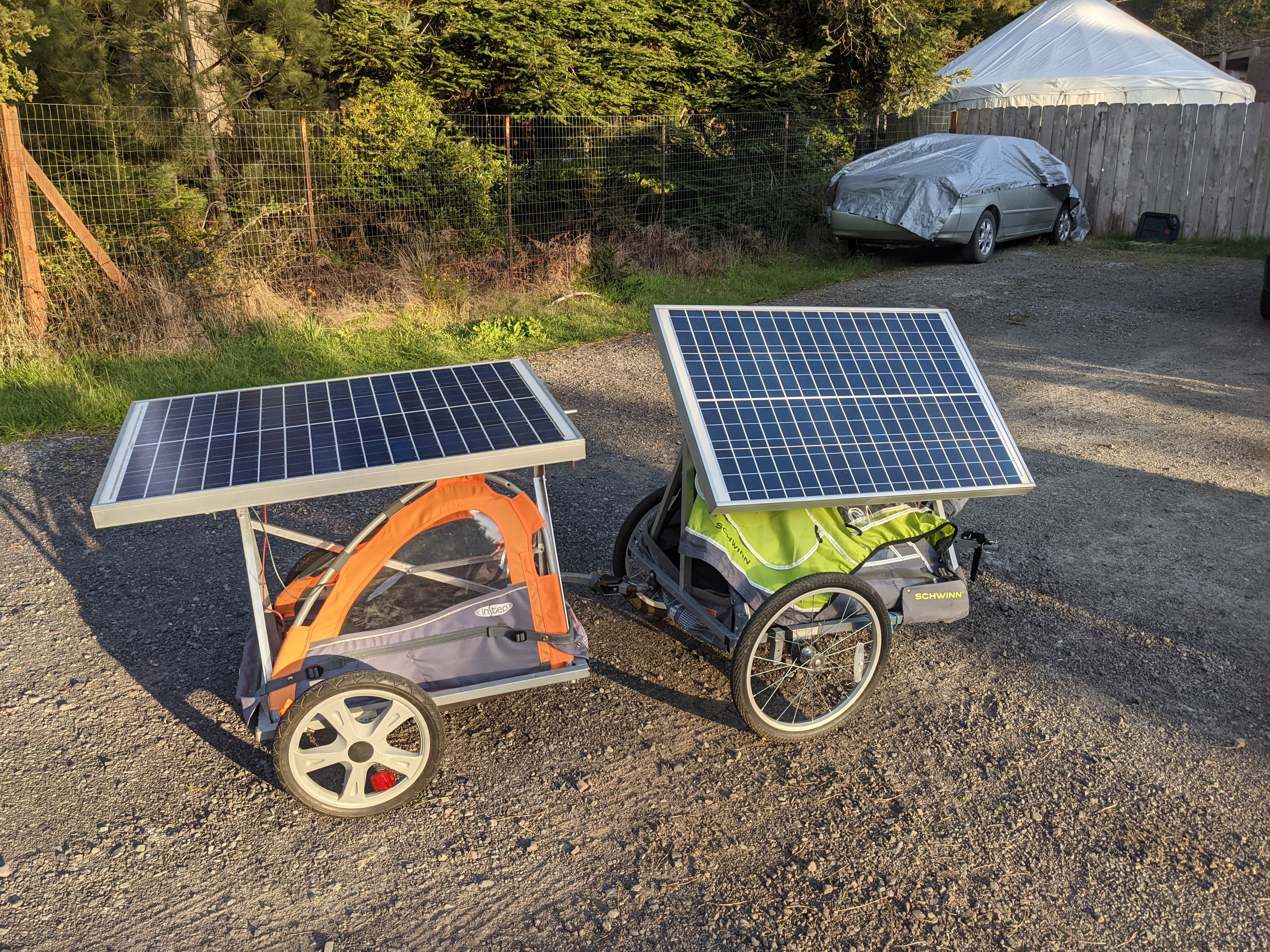 solar panel trailer connected using pivoting attachment arms