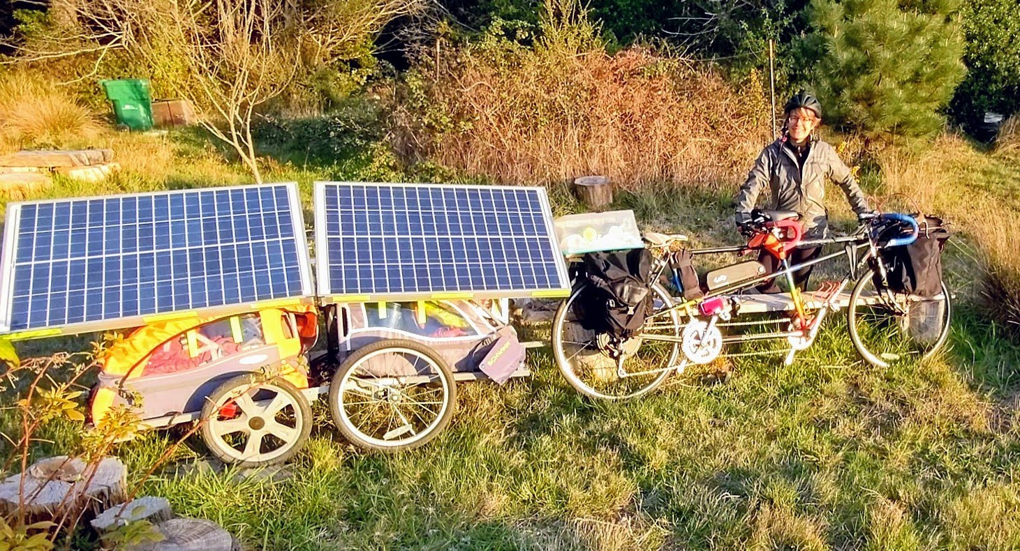 Claire holding ebike and solar trailer