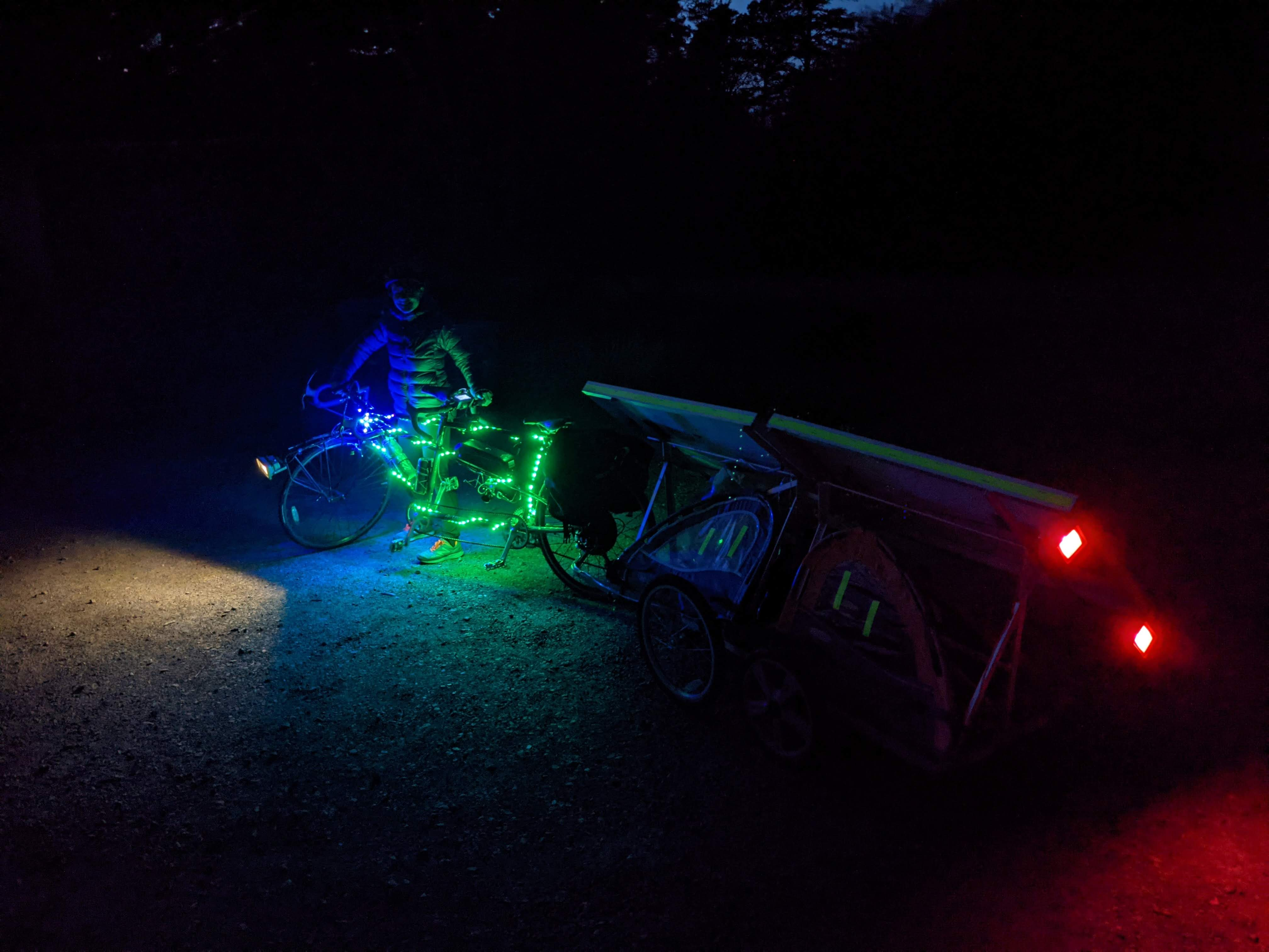 ebike trailer lit up with blue/green lights and tail light